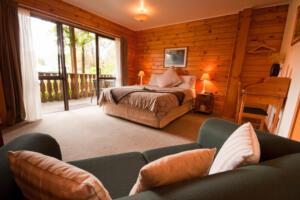 wood-paneled bedroom with large window