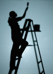 lady painter painting the ceiling