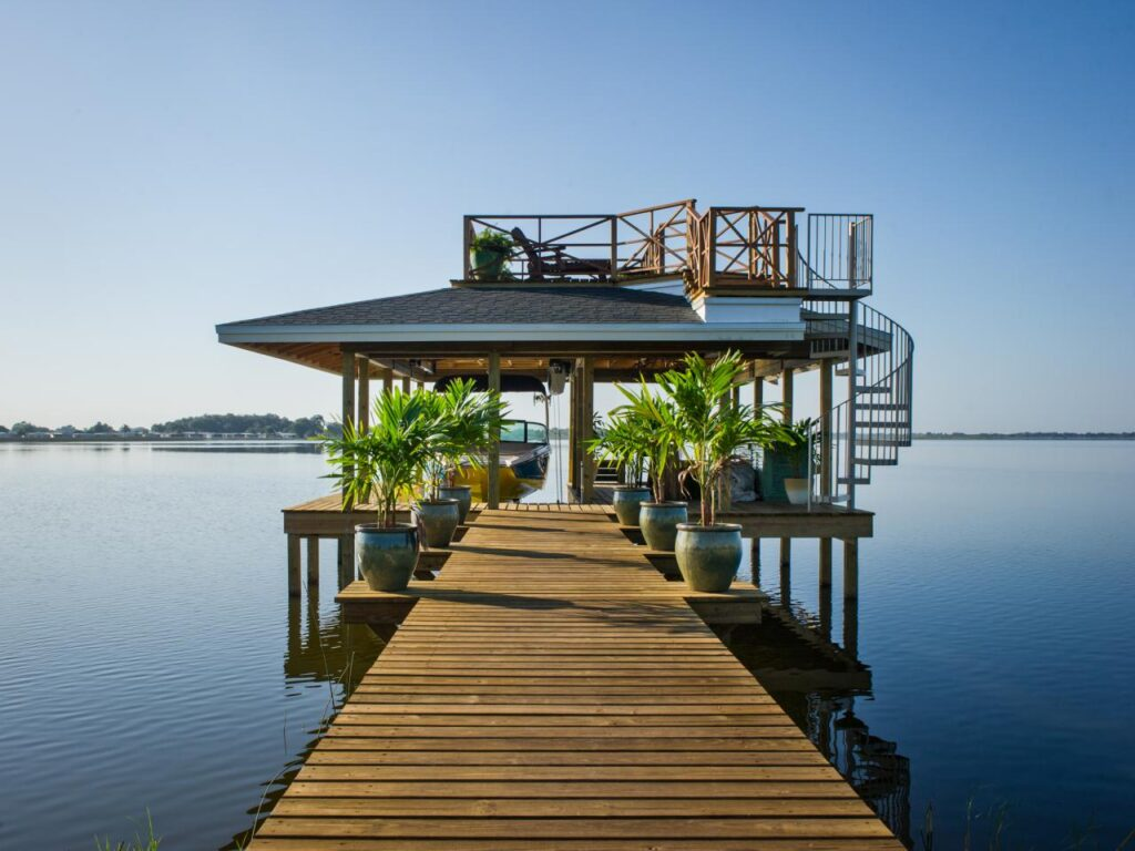 Dock with tropical themed boat house in Florida