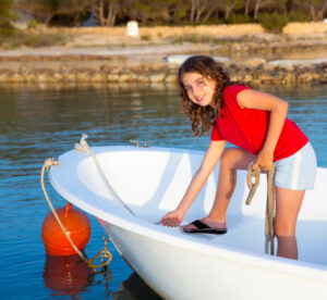 Girl With Safety Items On Boat