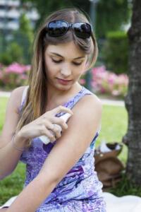 women using bug spray