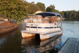 pontoon boat at sunset what boat type is best for you