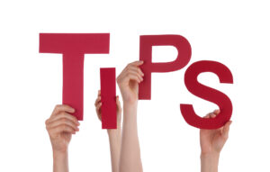 "hands holding up letters that spell ""tips"""