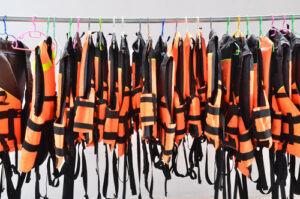hanging life jackets on a metal rod