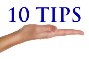"hand holding the words ""10 tips"""