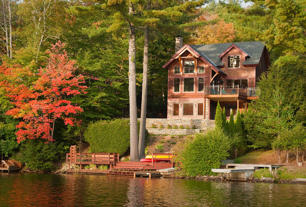 Vermont Lake Home on Shoreline during autumn | Lake Homes Realty