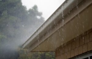 rain coming out of gutters