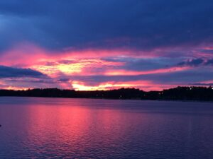 purple. yellow and pink sunset over open water