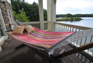 hammock on porch overlooking Lake Martin