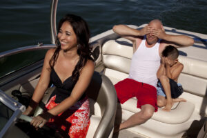Woman Boating with Man Covering his Eyes