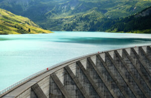 dam stopping turquoise blue water
