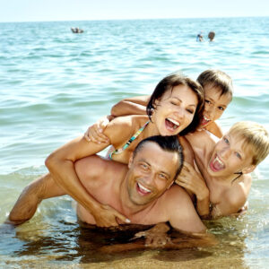 family of four in the water