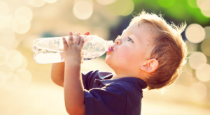 toddler drinking from a water bottle
