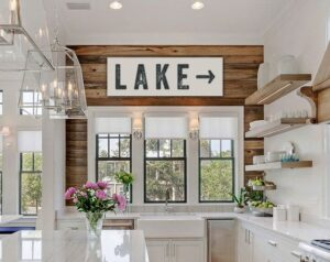 white and wooden kitchen with lake sign