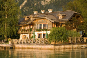 large waterfront wooden lake house with featured seewalll