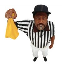 Referee with yellow penalty flag