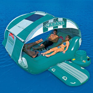 4 people relaxing on open water on cabana float