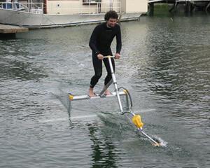 men riding on water bike