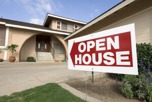 home with open house sign in front of it