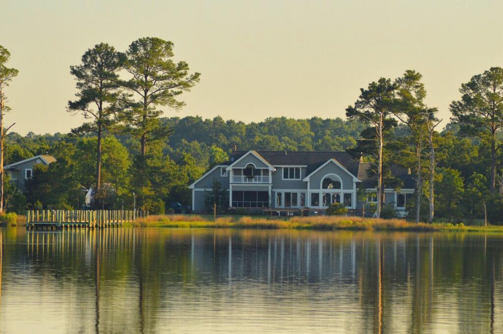 Lake house on serene water