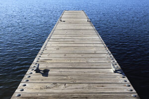 wooden boat dock/pier extending out into open water