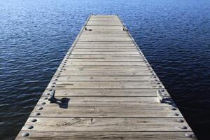 wooden boat dock/pier on open water