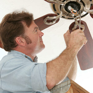 man installing ceiling fan