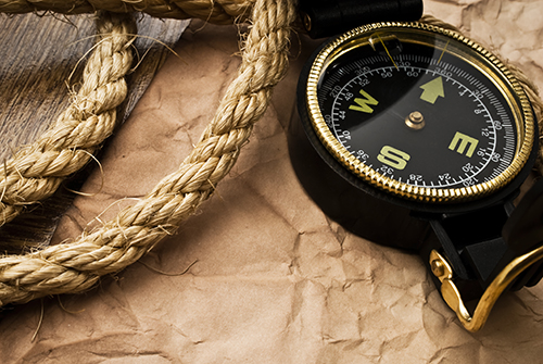 compass and rope over brown butcher paper