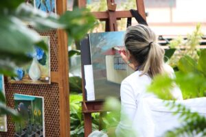 older woman painting outside