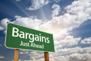 when to buy a lake home, bargains street sign