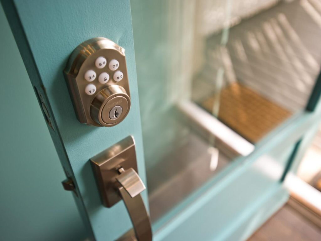Smart lock on blue glass front door