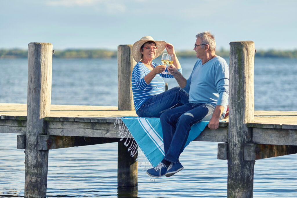 retired couple toasting on the dock on one of America's best retirement lakes