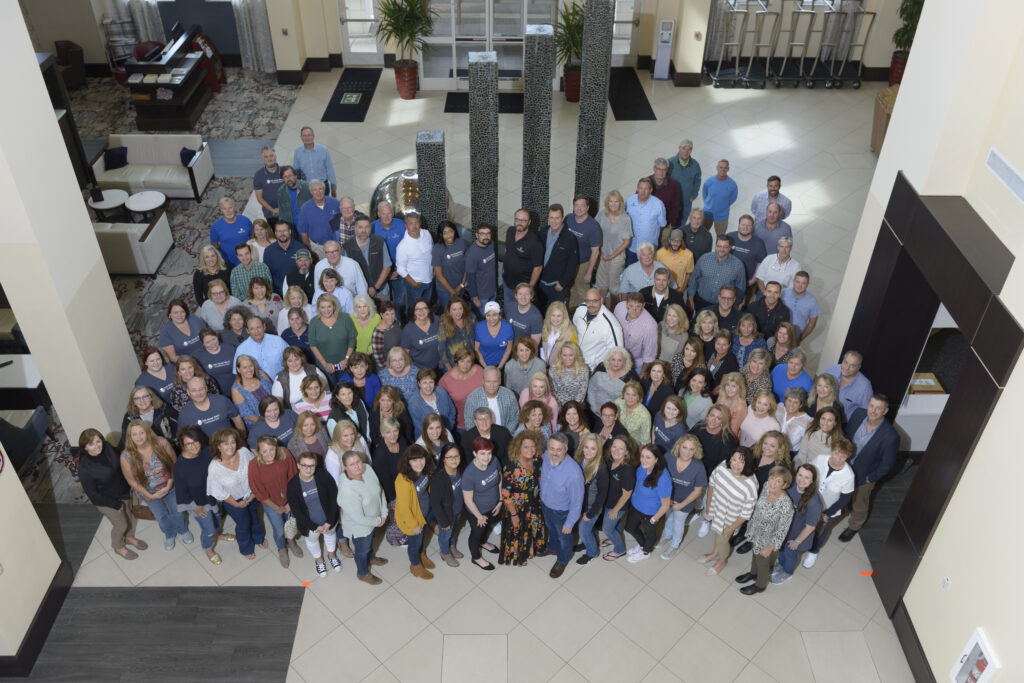 Lake Homes Realty agents and staff pose for a group photo during the Summit.