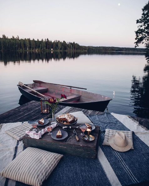 Lake dining on blankets during sunset