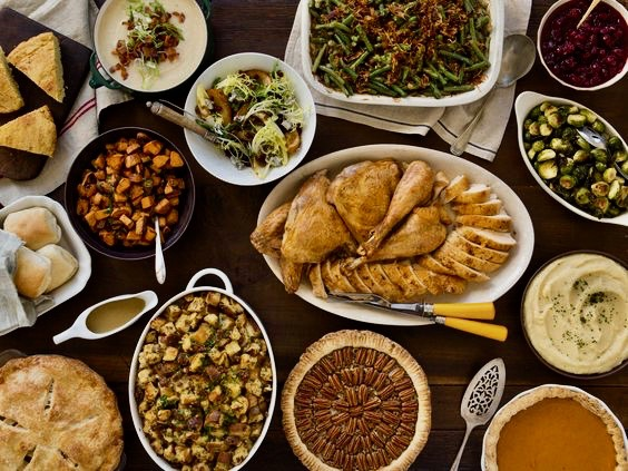 Thanksgiving Turkey Day Friendsgiving dinner laid out on table