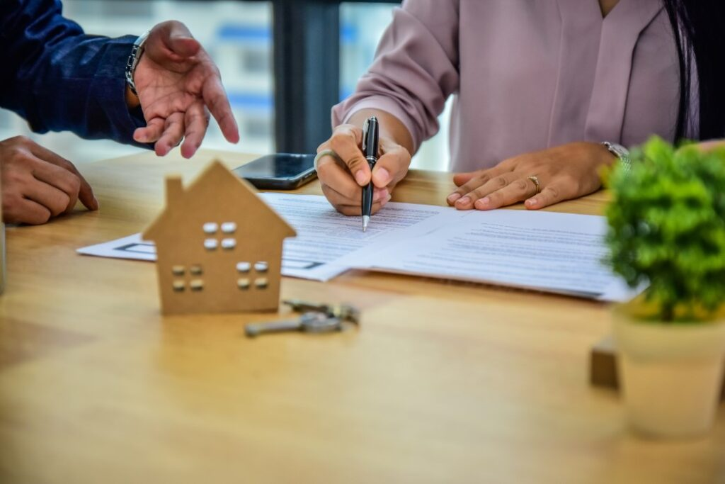 Person signing homeowner association contract the hidden costs of buying a lake home