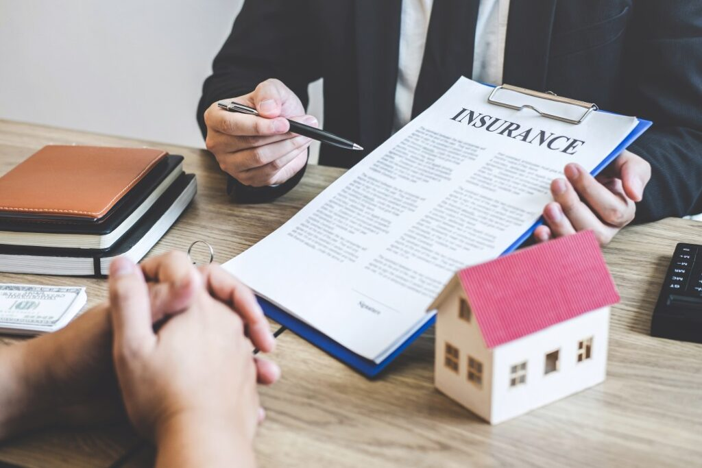 Person holding clipboard with insurance contract