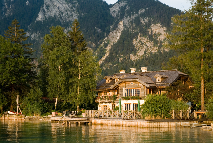 grand beautiful lake house building and maintaining a seawall on the lake
