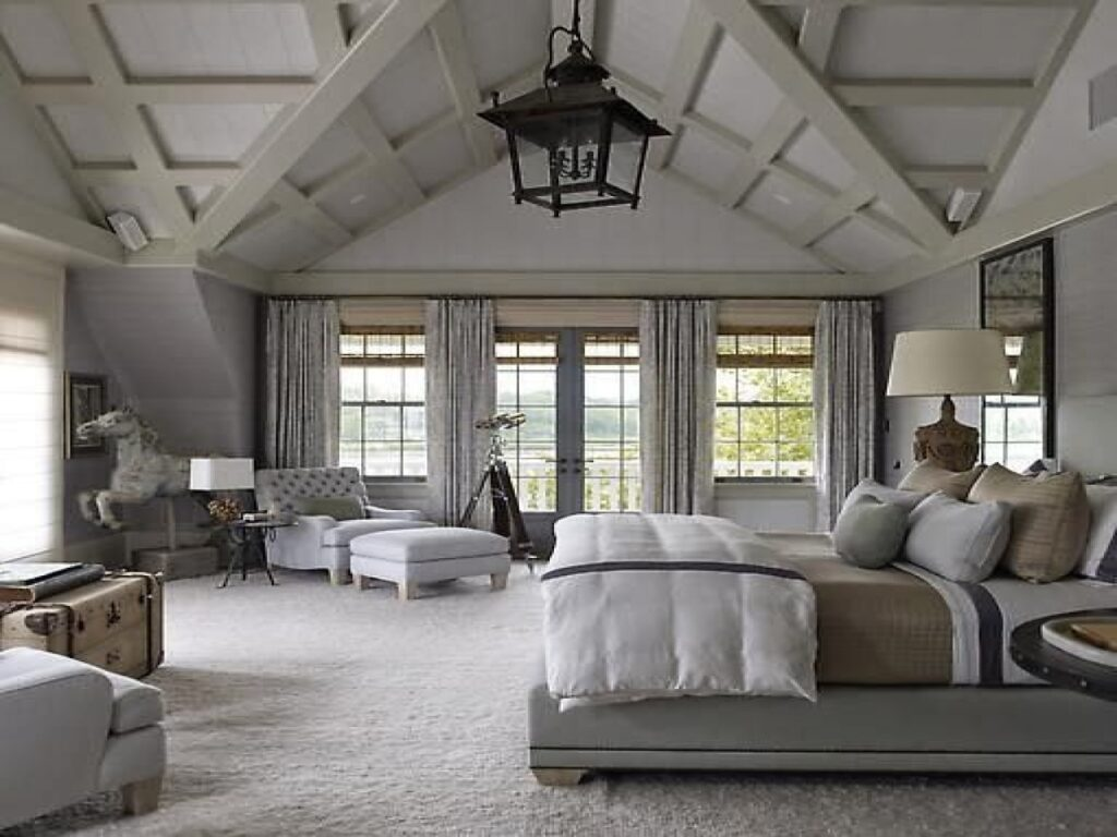 White farmhouse style bedroom with carpet lake house