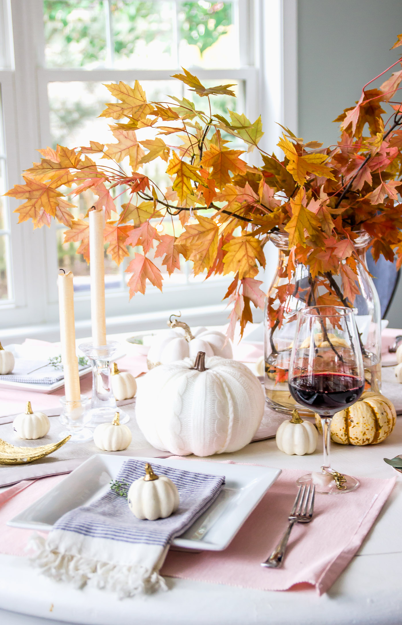 Autumn fall seasonal tablescape with white and gold pumpkins