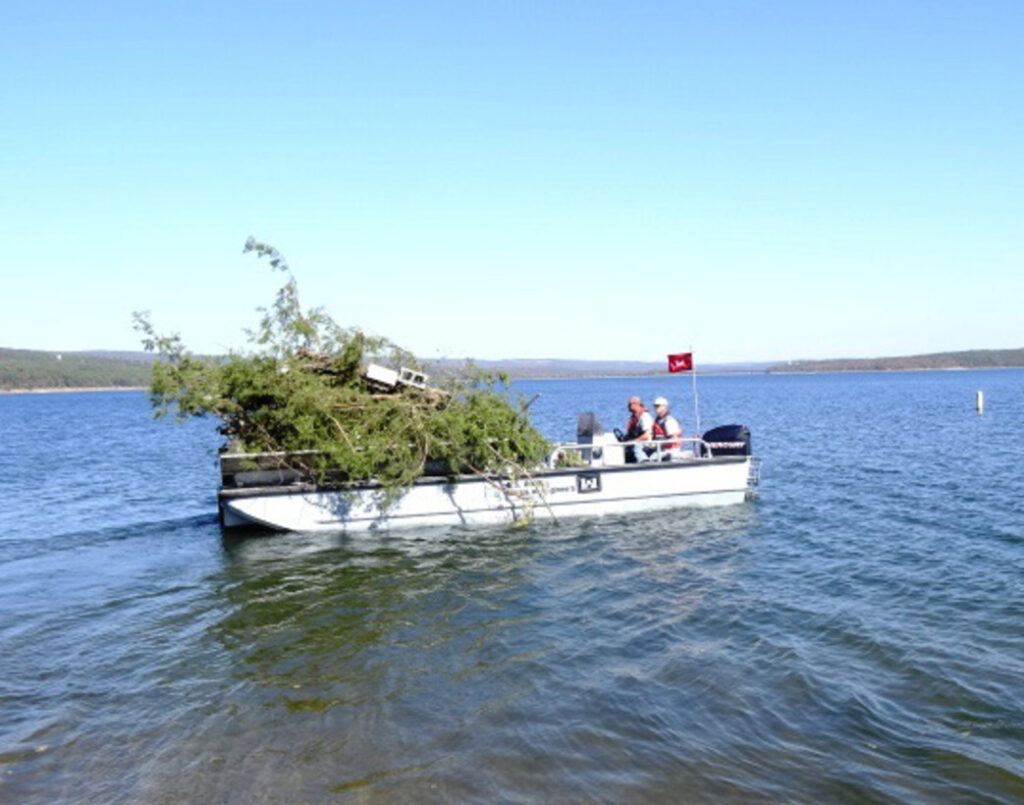 United States Army Corps of Engineering creating a fish habitat out of trees