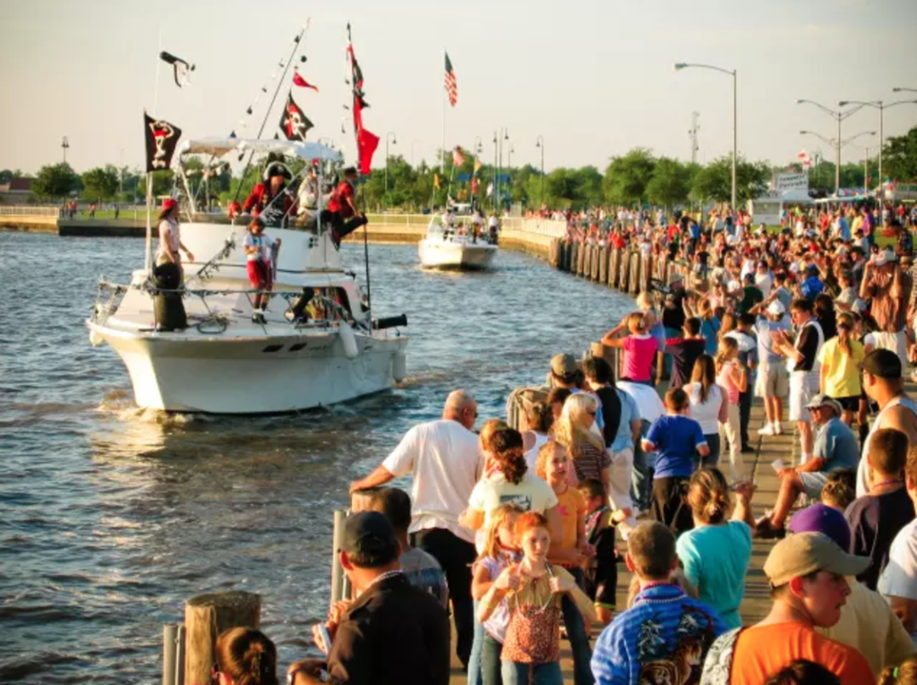 Lake Charles Pirate Festival boat on water with crowd