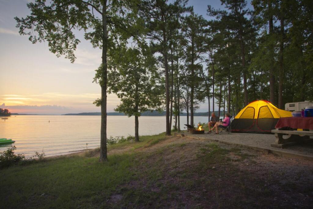 Family camping at lake