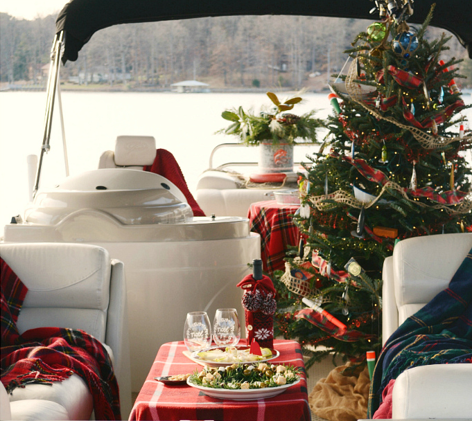 Decorated Christmas tree on boat on lake winter tradition