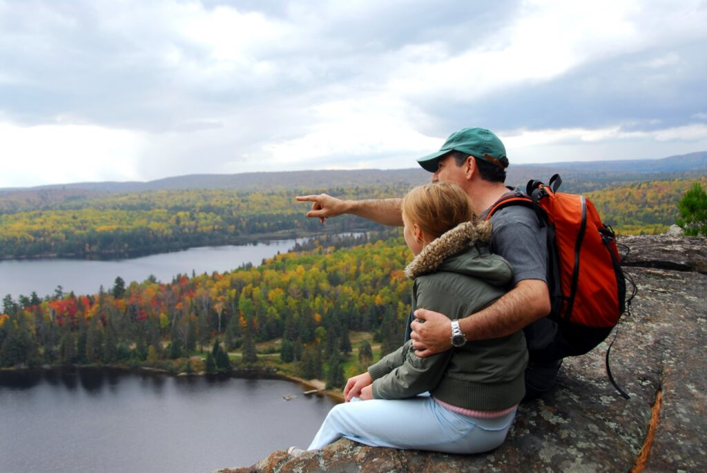 Father pointing to Moosehead Lake with daughter