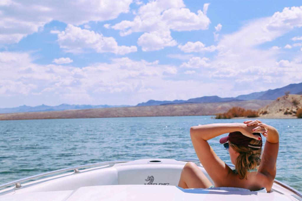 Woman relaxing on boat enjoying the view