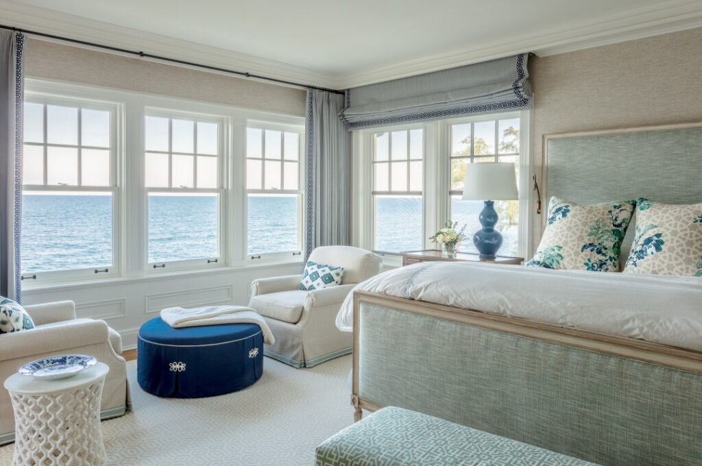 Nautical themed bedroom with view of lake