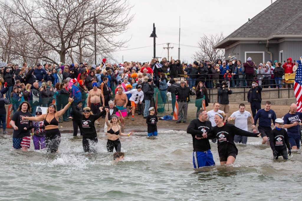 Participants take to the icy waters at Canandaigua Lake, NY