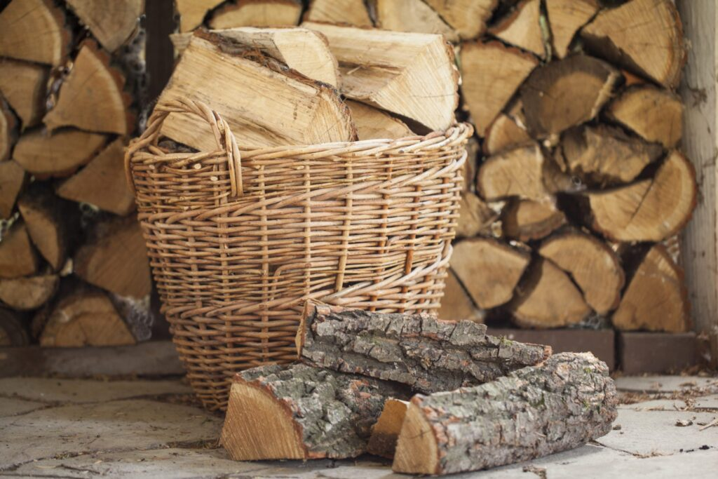 locally sourced chopped firewood in basket