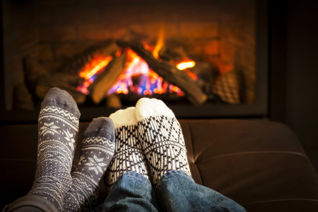 two people in front of fireplace